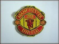 Шеврон Манчестер Юнайтед
